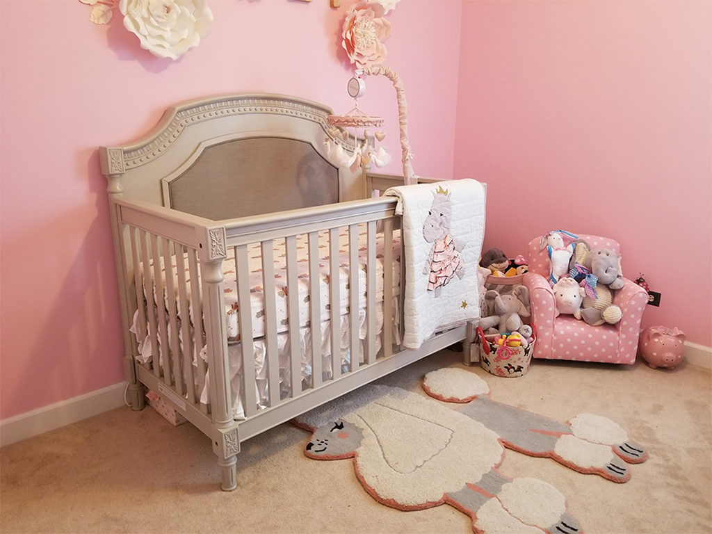 Balance out a pink color palette with gray or beige nursery furniture - Featured here is the Evolur Julienne 5-in-1 Convertible Crib.