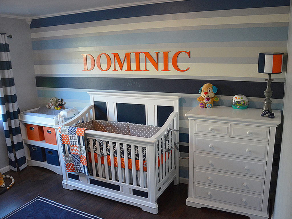Pops of orange brighten up this blue and white nursery