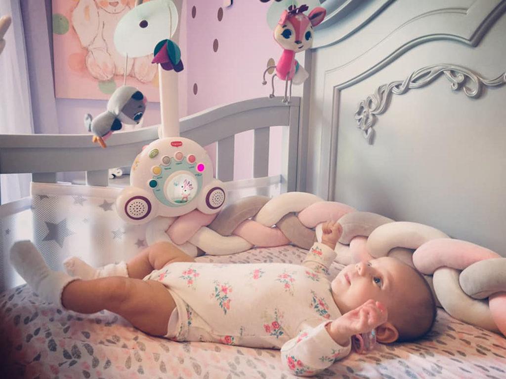 Baby Lilith's charming Evolur Aurora Nursery Image 1