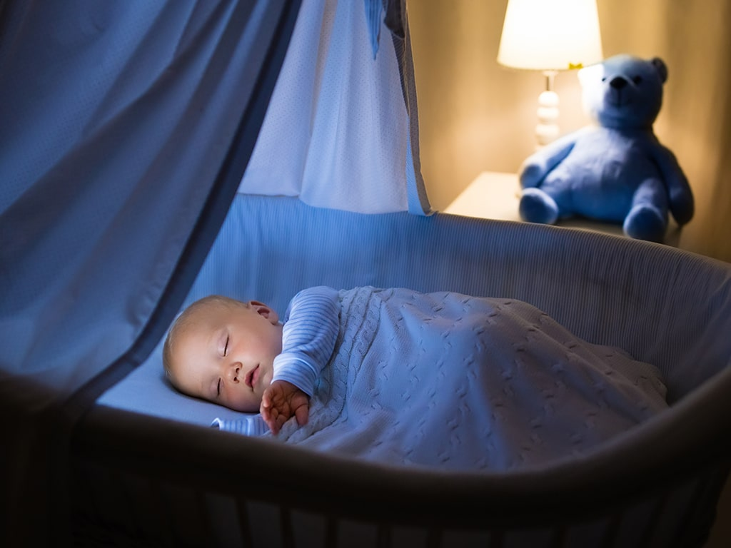Baby Rolling Over in Bassinet